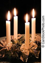 Christmas advent wreath with burning candles laid on table ...