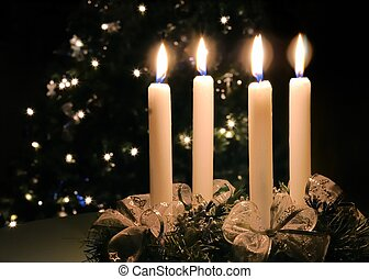 Christmas advent wreath with burning candles. Lights on x-...