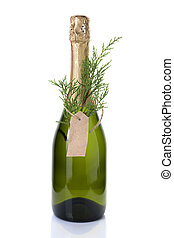 Christmas alcohol, a bottle of champagne decorated with a coniferous branch.