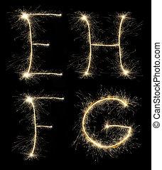 Christmas alphabet created a sparkler on black
