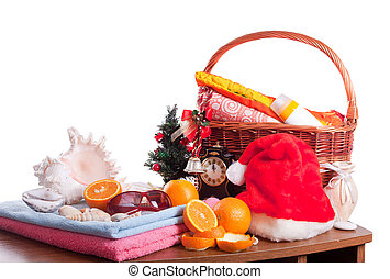 Christmas and beach accessories over white