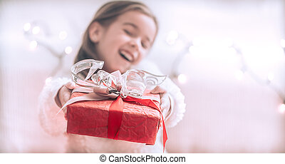 Christmas and Holiday concept little girl with a gift