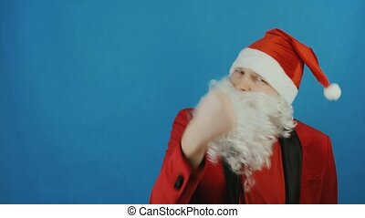 Christmas and New year 2019, man like a Santa Claus shows fist at camera, on blue background