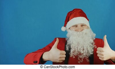 Christmas and New year 2019, man like a Santa Claus shows thumbs up like, on blue background