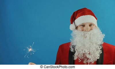 Christmas and New year 2019, man like a Santa Claus with sparkler, blue background