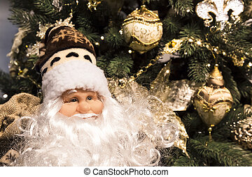 Christmas and New Year background. Santa Claus on the background of a Christmas tree decorated for celebration.