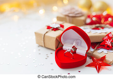 Christmas and New Year background with engagement ring and...