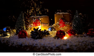 Christmas and New Year background with gifts. Presents wrapped in craft paper with holiday symbols - heart and fir tree. Snow is falling from above.