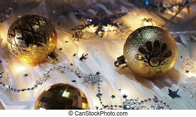 Christmas and New Year background with shiny balls, sparkling snowflakes and confetti.