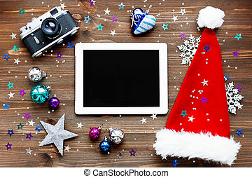 Christmas and New year background with tablet, Santa's hat,...