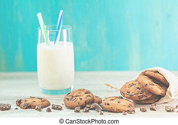 Christmas and New Year composition with delicious chocolate cookies and glass of milk