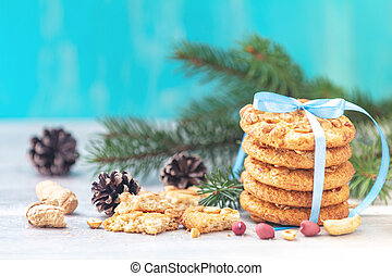 Christmas and New Year composition with delicious peanut cookies and peanuts on light table