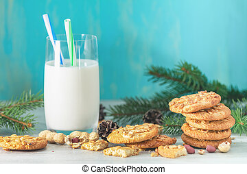 Christmas and New Year composition with delicious peanut cookies, peanuts and glass of milk