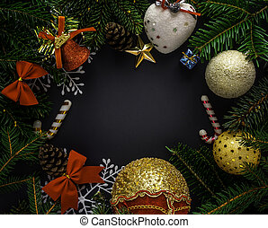 Christmas and New Year composition with tree branches on black background