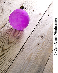 Christmas and New Year Concept 2018. Pink New Year's ball on a wooden board