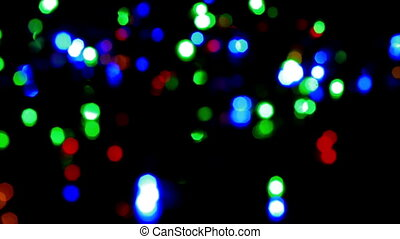 Christmas and new year decoration. Abstract blurred bokeh blinking garland. Holiday background Christmas tree lights twinkling