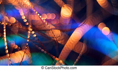 Christmas and New Year Decoration. Abstract Blurred Bokeh Holiday Background. Blinking Garland. Christmas Tree Lights Twinkling.