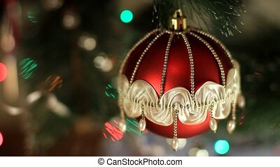 Christmas and New Year Decoration. Red Christmas ball on Christmas tree