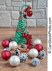 Christmas and New Year decorations are lying on a wooden flooring.