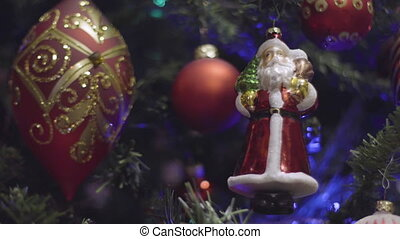 Christmas and New Year Decorations on holiday tree. Abstract...