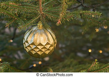 Christmas and New Year holidays background. Christmas tree decorated with gold  balls. Celebration concept