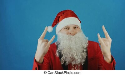 Christmas and New year, man like a Santa Claus shows a signs of the horns, on blue background