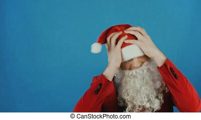 Christmas and New year, man like a Santa disappointed and shakes his head, on blue background