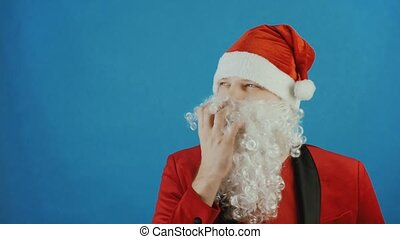 Christmas and New year, wondered man like a Santa thinks and ponders, on blue background
