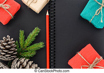 Christmas and New Year's gifts on a background of a notepad paper Kraft
