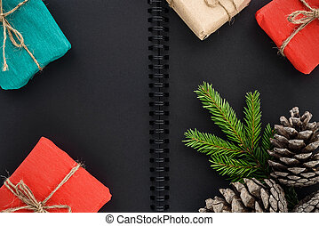 Christmas and New Year's gifts on a background of a notepad