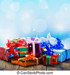 Christmas and New Year's gifts on a blue background with space