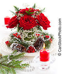 Christmas arrangement of red roses, fir, holly and pine ...