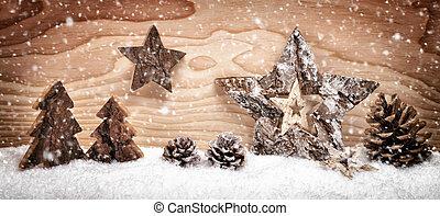Christmas arrangement with wooden decoration