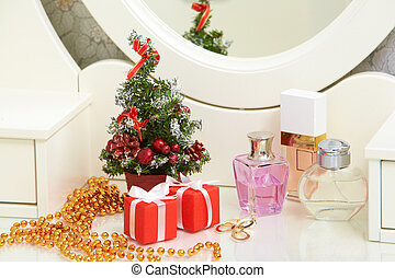Christmas composition on lady toiletries table