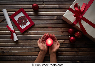 Christmas atmosphere - Image of female hands holding burning...