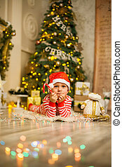 Christmas baby boy with red candy cane