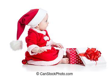 christmas baby girl opening gift box isolated on white background