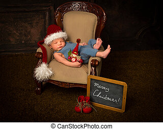 Christmas baby in armchair