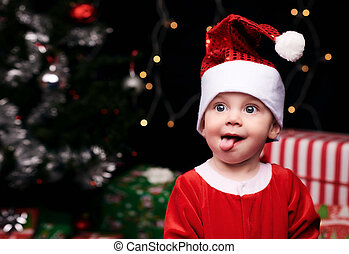 Christmas baby sticking tongue out toward camera - Baby...
