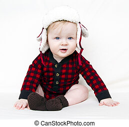 Christmas baby with red plaid shirt and furry wool hat -...