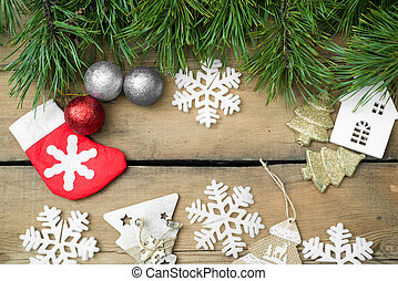 Christmas holiday background 2018, 2019. Christmas lights lie on dark, old boards. New Year background. Christmas decorations. Xmax background. Christmas tree.