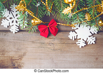 Christmas decorations on old dark boards. Christmas background. New Year background. Xmax background. Christmas tree. Toned image.