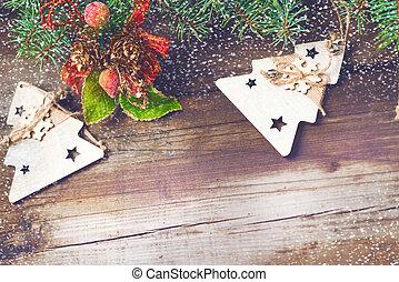 Christmas decorations on oldboards. Christmas background. New Year background. Xmax background. Christmas tree. Snow falls.