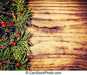 Christmas Background Border. Green Twig of Christmas Tree on Wooden Background