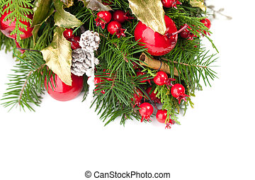 Christmas background border with green Xmas tree twig, red berries and New Year decoration