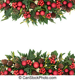 Christmas background border with red bauble decorations, holly, ivy, mistletoe, fir and pine cones on white.