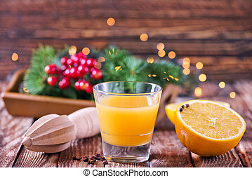 Christmas background, Christmas decoration on orange drink...