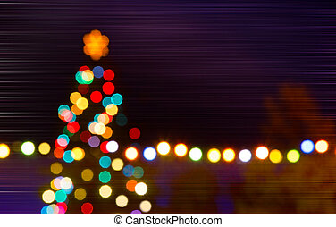 Christmas tree with unfocused tree in the night, composite image