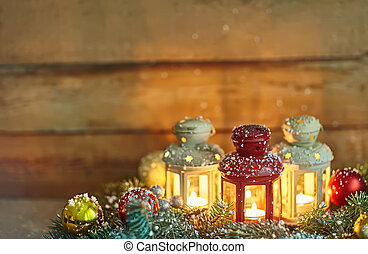 Christmas background composition with lanterns, baubles and fir in snow