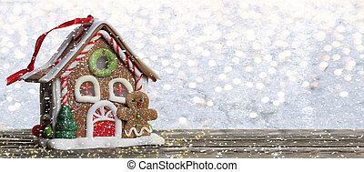 Christmas background. Fairytale house on a wooden board